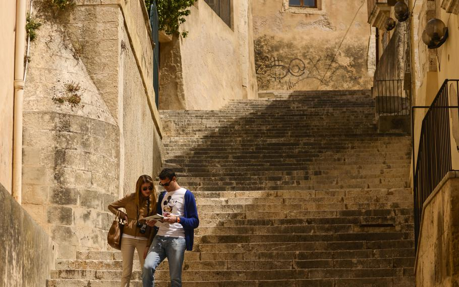 A young couple explores the nooks and crannies of Noto, Sicily.