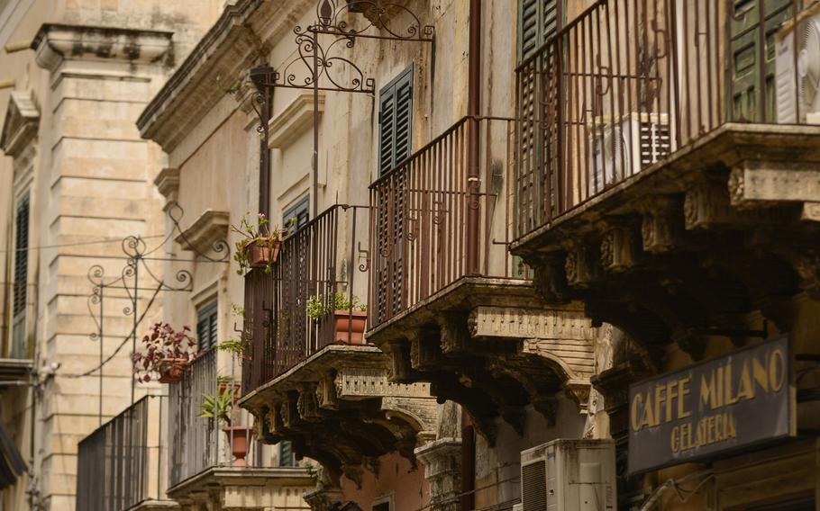 Ornate balconies line the streets in Noto's, Sicily.