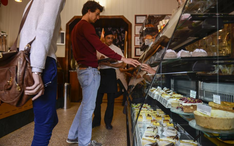 Customers choose baked goods from Noto's Caffe Sicilia.