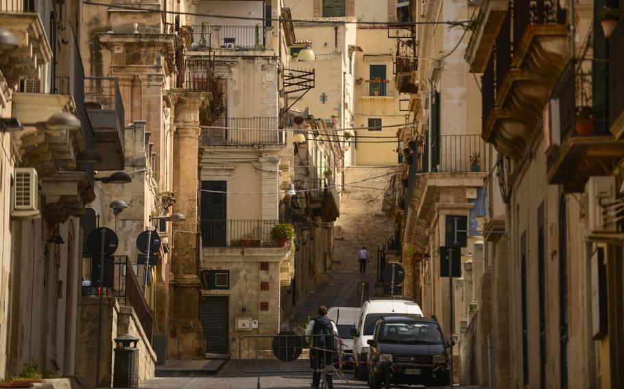 A typical street scene in Noto, Sicily, displaying Baroque architecture.