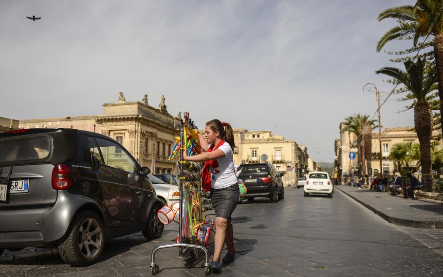 A street vendor wheels her wares into position along the Corso Vittorio Emanuele, Noto's main street.