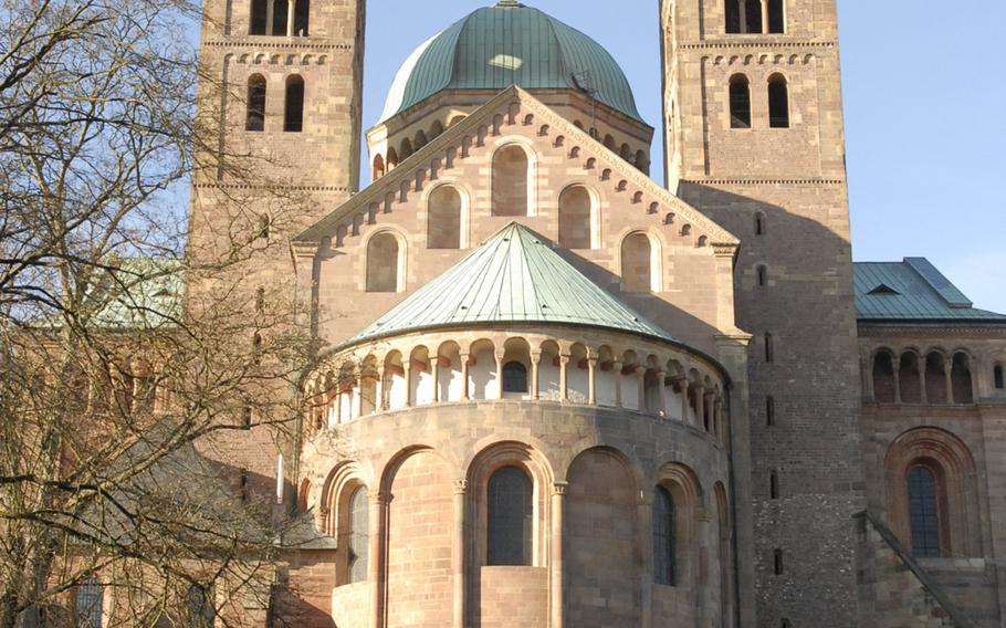 The east end of the Speyer cathedral, as seen from the garden behind the basilica. Officially known as the Cathedral of St. Mary and St. Stephen, the cathedral in Speyer, Germany, is steeped in history, a massive block of rock that stands as a timeless piece of Romanesque architecture.