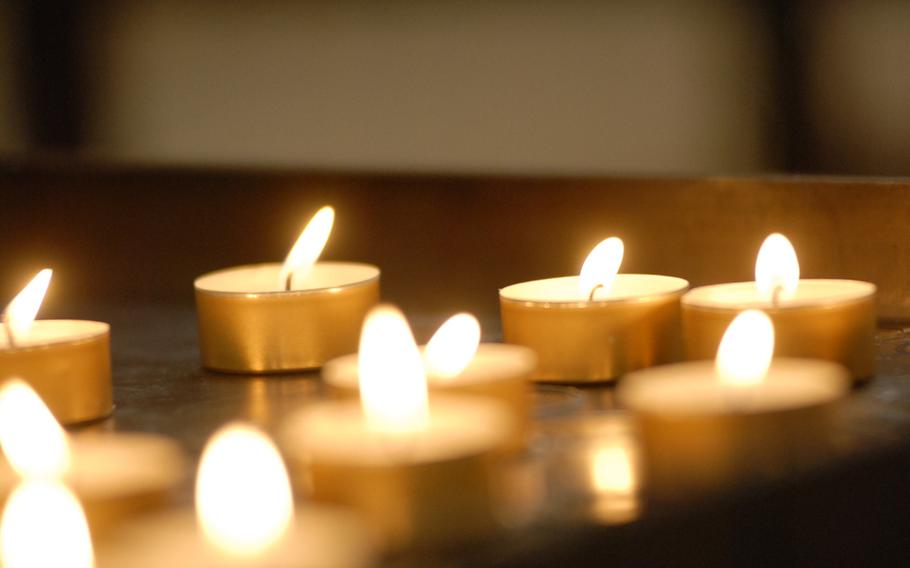 Lighted candles lend a peaceful ambience to the cathedral in Speyer, Germany.