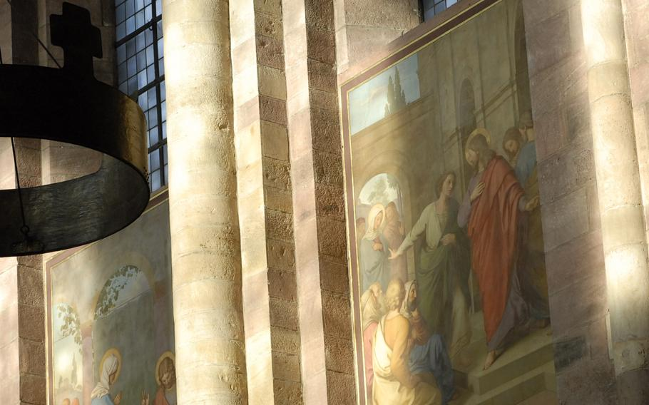 Paintings depicting scenes from the Bible are bathed in natural light inside the cathedral in Speyer, Germany.