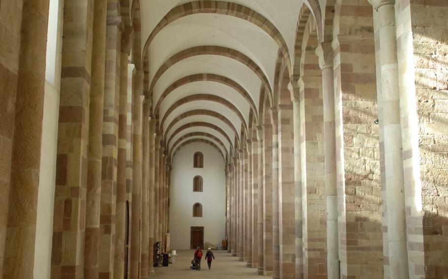 Visitors look tiny inside the massive cathedral in Speyer, Germany. The massive rock basilica is the largest surviving Romanesque cathedral. Original construction finished in 1061, though much of the structure was destroyed and rebuilt over the years.