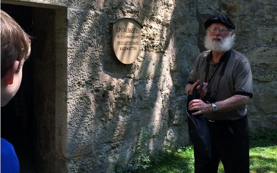 With decades of travel experience under his belt, Wiesbaden Child, Youth and School Services tour guide Patrick Hoban leads tourists from the Wiesbaden, Germany, area around nearby Rothenburg.