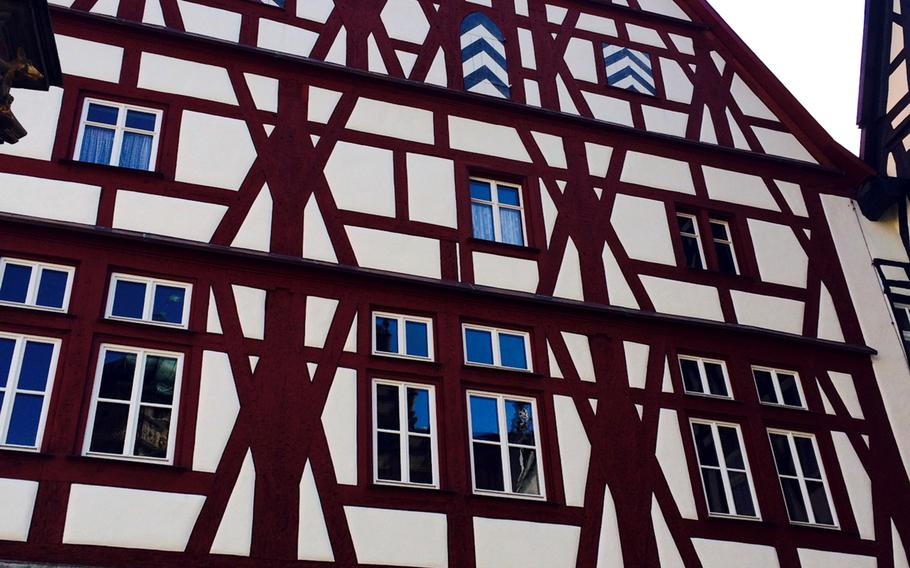 Many of Rothenburg, Germany's beautiful structures, such as this one, are half-timbered buildings. This pretty-as-a-picture Bavarian town draws tourists from around the world.
