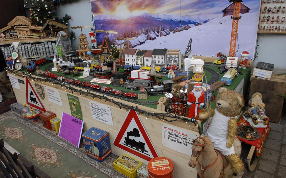 An impressive toy train set, on display in December 2013 at the Speyer Christmas Market, stood outside a vintage toy shop in Speyer, Germany.