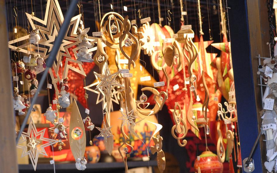 Hand-carved wooden Christmas ornaments hang from a stall in December 2013 at the annual Christmas market in Speyer, Germany.