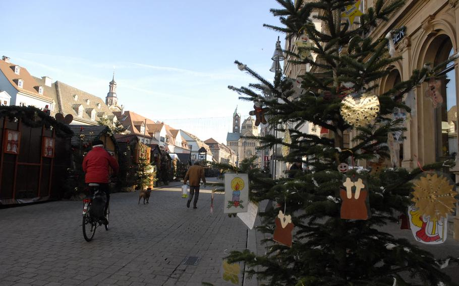 A Christmas tree adorned with handmade decorations adds to the festive spirit of the Speyer Christmas Market in December 2013. Stalls are set up along the city's old section, between the Speyer Dom (cathedral) and the Old Mint building.
