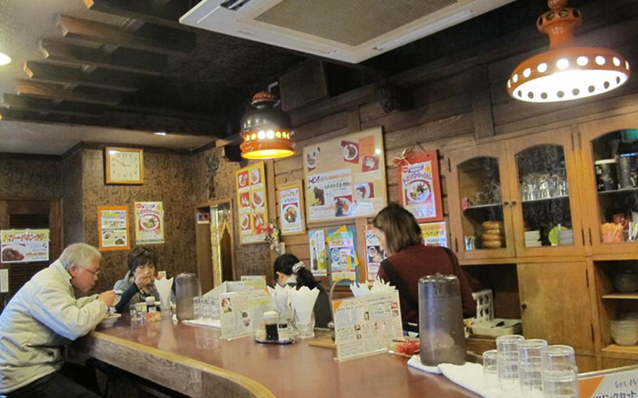 Bengal's counter and decor give the restaurant a nostalgic feel for its Japanese customers.