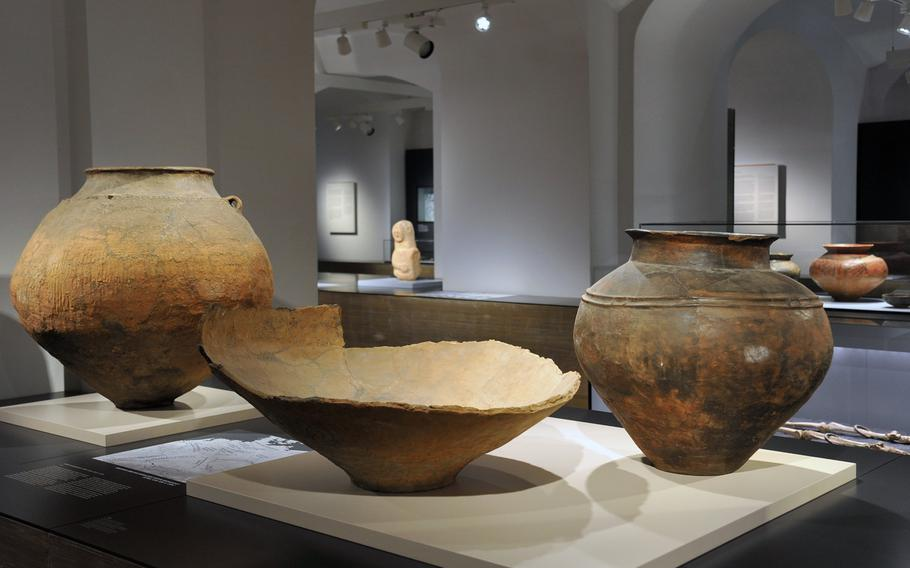 An urn and storage vessels from the Bronze Age, about 1300-1200 B.C. are on display at the Hesse State Museum in Darmstadt, Germany.