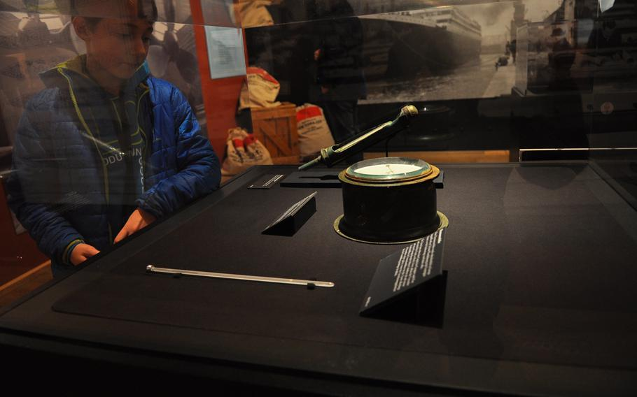 A boy looks at a ship barometer, one of nearly 250 artifacts from the Titanic salvaged from the sea floor that are on display until June 28, 2015, at the Historical Museum of the Palatinate in Speyer, Germany.