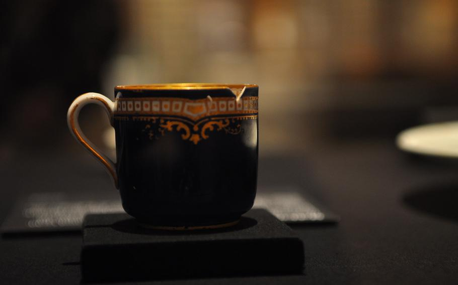 This delicate porcelain tea cup salvaged from the Titanic's sea-bottom wreckage remains remarkably intact, minus a small chip. It's on display at the Titanic exhibition.