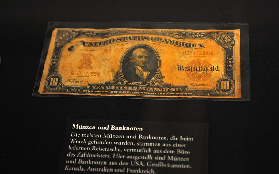 Numerous bills and coins were pulled from the Titanic's wreckage, including this outdated U.S. $10 bill. It is on display along with other artifacts from the sunken ship.