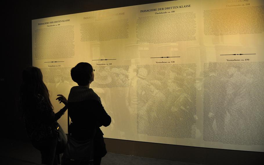 Visitors to the Historical Museum of the Palatinate in Speyer, Germany, look at the list of passengers and crew aboard the ill-fated RMS Titanic. Passengers are divided by first, second and third class. More than half of those in first class survived.