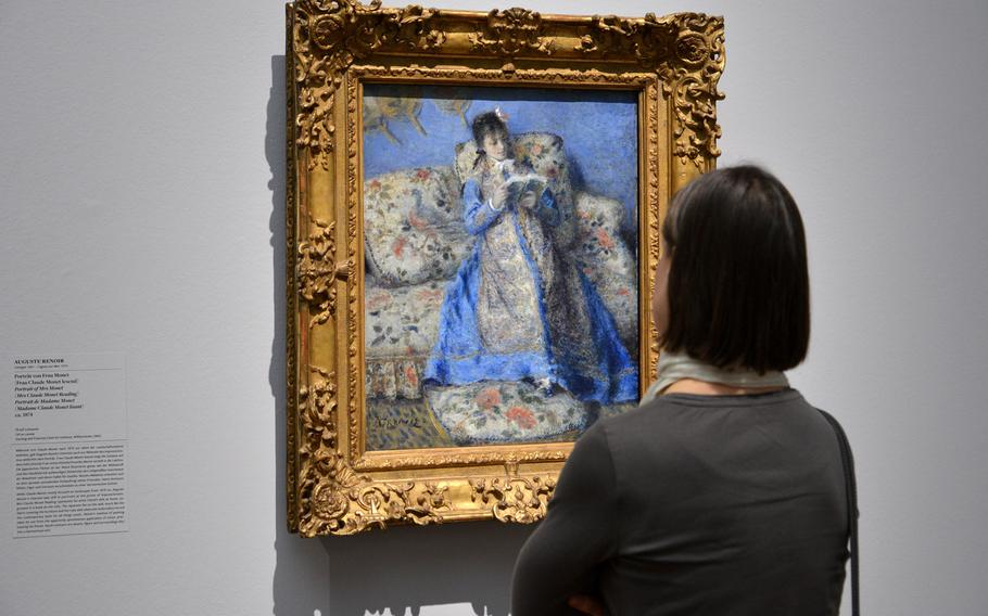 """Auguste Renoir's """"Portrait of Mrs. Monet (Mrs. Claude Monet Reading)"""" is on display at the """"Monet and the Birth of Impressionism"""" exhibit at the Städel in Frankfurt, Germany"""