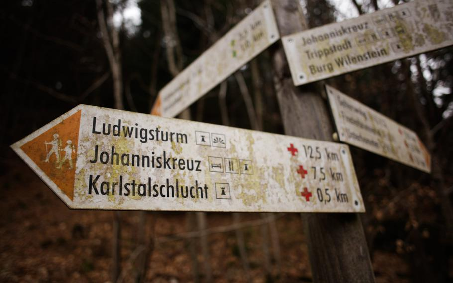 Trail signs direct hikers to various locales near the Karlstalschlucht, which is connected to the  Pfälzerwald  region's larger trail system.