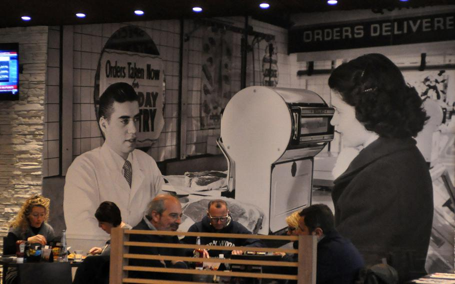 Scenes that could have been pulled out of a America several decades ago dot the walls of the Roadhouse Grill in the Tiare shopping mall near Villesse, Italy.