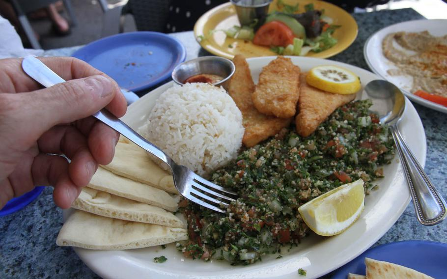 A heaping portion of tabouleh is the center of this lunch plate at Greek Marina restaurant. With it are calamari steak, rice, pita bread and a garlic dipping sauce.
