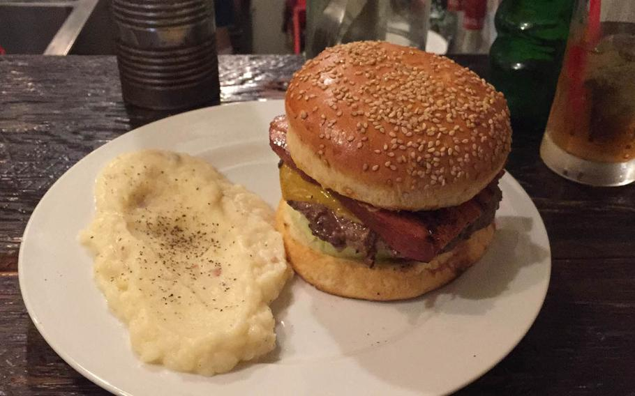 The Kevin Bacon Burger at Whoopi Gold Burger in Tokyo's Shibuya district features a large, thin patty topped with two thick slices of sweet and smoky bacon, lettuce, tomato, onion and mild cheddar cheese. Diners can choose between french fries or mashed potatoes sprinkled with pepper and bits of bacon.