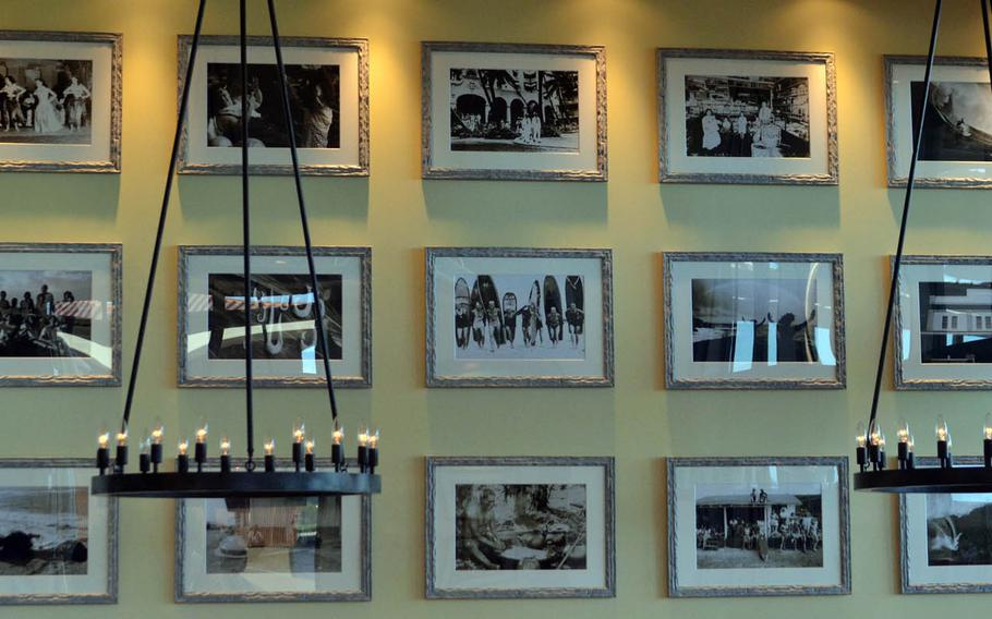 Photographs of all things Hawaii adorn the walls of Roy's Hawaii, which opened April 25, 2015, at Aeon???s Okinawa Rycom resort mall, one of the largest on the island.