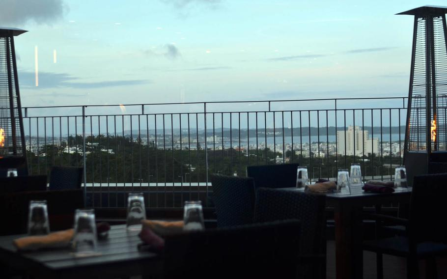 Diners at Roy's Hawaii in Okinawa may enjoy a view of Awase village and the Pacific Ocean.