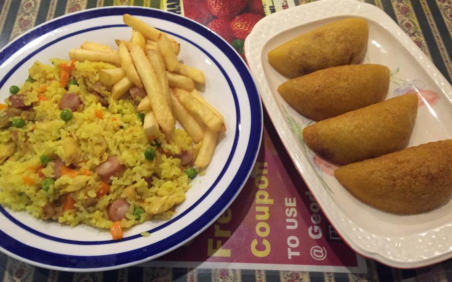 Arrozo con pollo and empanadas from Geodana, a Latin-American restaurant near Yokosuka Naval Base, Japan.