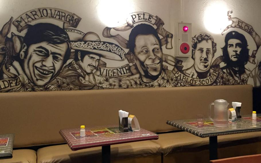 A mural featuring people such as Che Guevara and Pablo Escobar covers the walls at Geodana, a Latin-American restaurant near Yokosuka Naval Base, Japan.