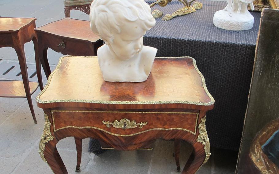 Cherubic busts and antique tables are common items for sale at Vicenza's antiques and collectibles market, held on the second Sunday of the month.