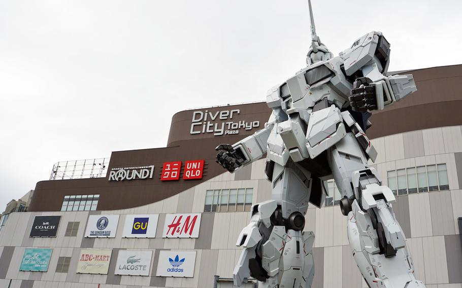 The Unicorn Gundam statue stands guard in unicorn mode outside of Diver City Tokyo Plaza in Odaiba, Tokyo, Thursday, Sept. 28, 2017.