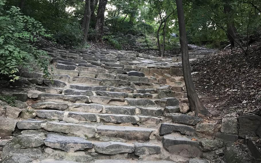 Stone steps that blend into nature illustrate the harmony that distinguishes the Secret Garden, a former royal retreat behind the Changdeokgung Palace in Seoul during a tour on Sunday, Oct. 8, 2017.