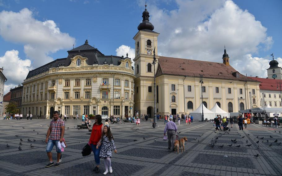 Sibiu's Piata Mare or Great Square, is the heart of the Romanian city. At center is the 18th-century baroque Catholic church.