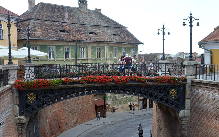The Podul Minciunilor, or Bridge of Lies in Sibiu, Romania. It crosses over a street that leads from the upper town to the lower town. Built in 1859, it was the first wrought iron bridge in Romania.