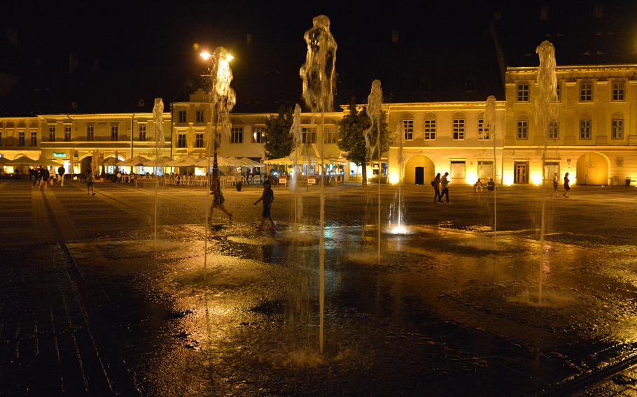 Sibiu's Piata Mare or Great Square with its fountain at night.