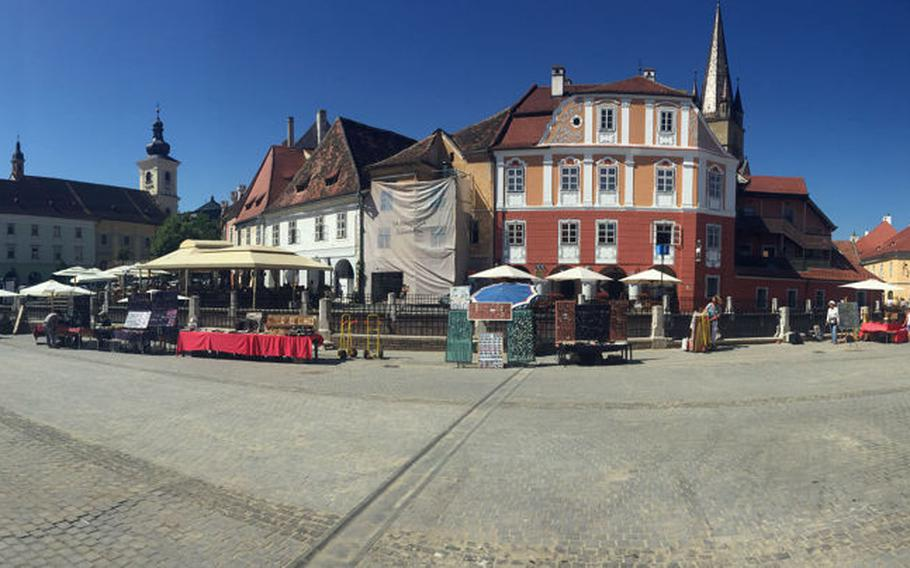 An iPhone panorama of Sibiu, Romania's Piata Mica, or Little Square with its historic old buildings..