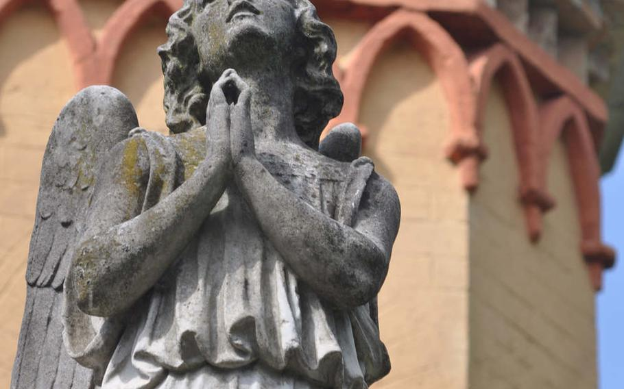 An angel statue offers a prayer atop the chapel at Parco di Villa Vardi near Brugnera, Italy.