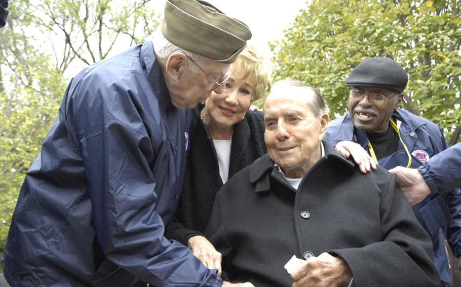 Former Senator Bob Dole visits with veterans at the World War II Memorial in Washington, D.C., on Saturday.