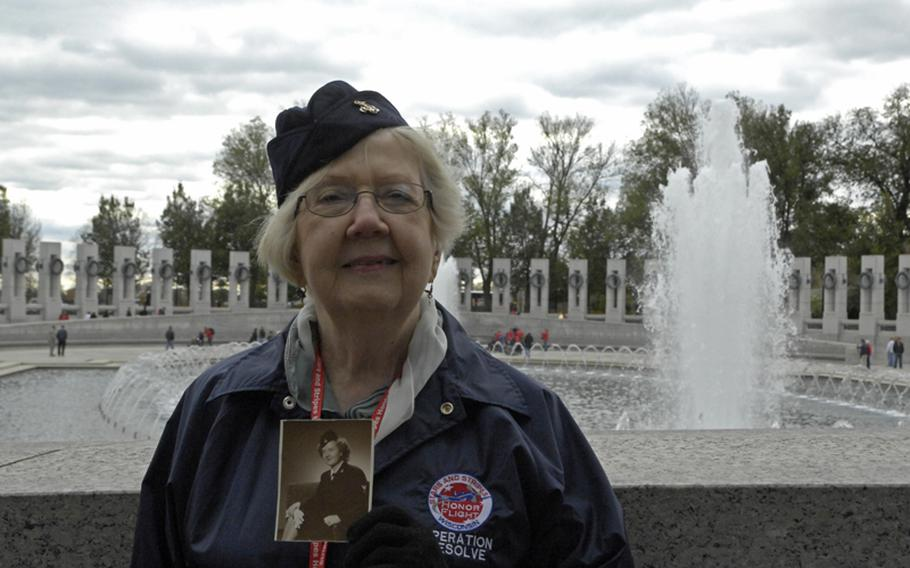 Navy sailor Doris Zimmermann with the Stars and stripes Honor Flight.