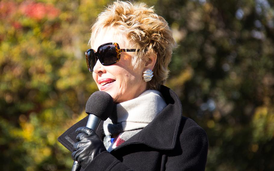 Jan Daley, Bob Hope Tour Vietnam USO Entertainer, on a microphone check a the Annual Veterans Day Observance at the Wall event on November 11, 2013 in Washington, D.C.