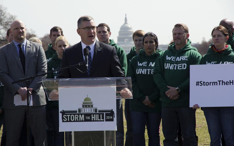 Sen. John Walsh, D-Mont., speaks at an IAVA event on the National Mall after introducing a new bill aimed at stopping veteran suicides on the National Mall in Washington, D.C., on March. 27, 2014. IAVA planted 1,892 flags on the National Mall, each representing the number of veterans and servicemembers estimated to have committed suicide so far in 2014.