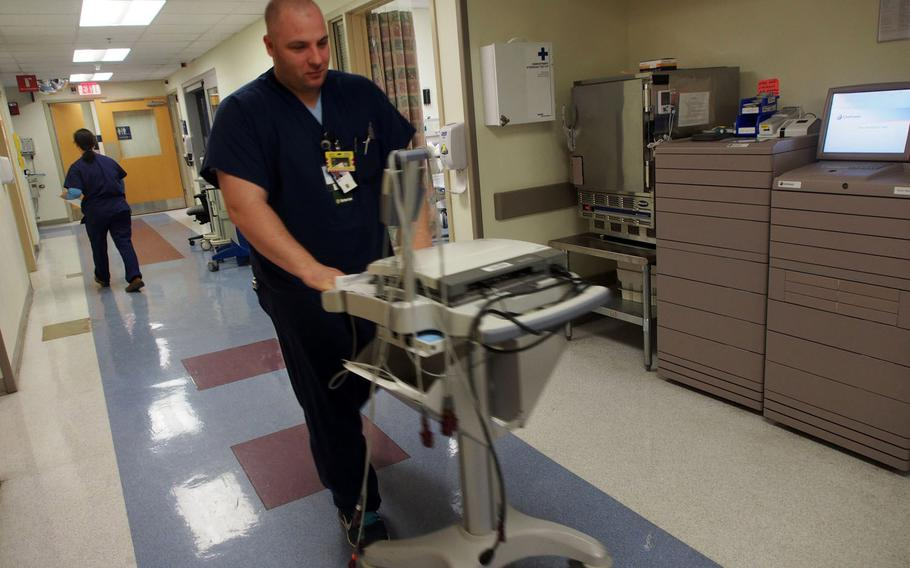 Former Army combat medic Joe Carney is working as an intermediate care technician at the James Lovell Federal Health Care Center in North Chicago. The position was created by the Department of Veterans Affairs to help former medics and Navy  corpsmen find employment and help VA fill a shortage of healthcare professionals.