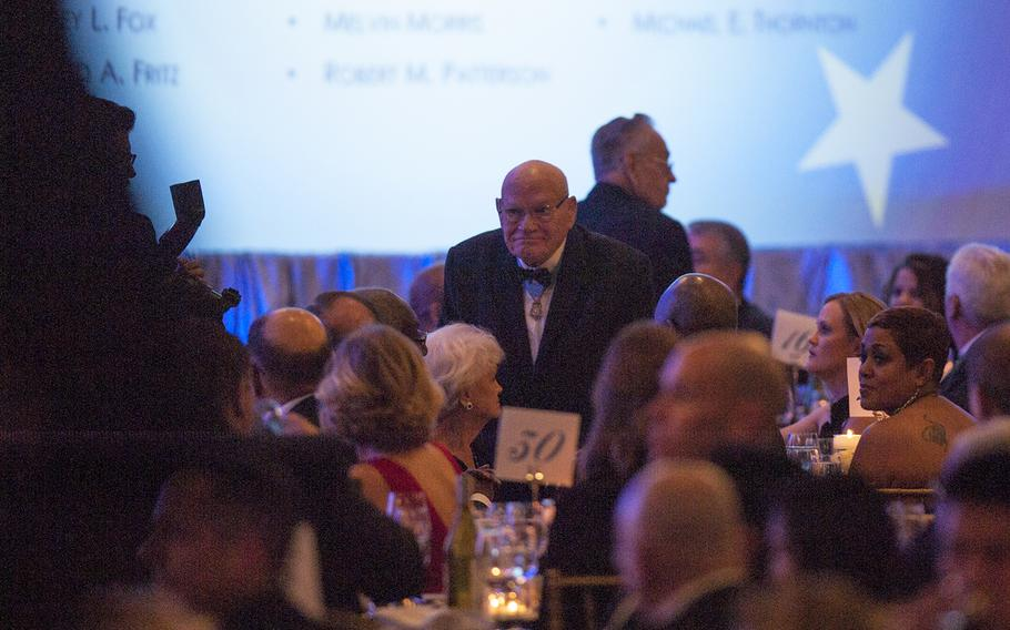Medal of Honor recipient Bennie Adkins, a retired Army soldier, stands as his name is read out loud during the  Veterans Inaugural Ball: Salute to Heroes in Washington, D.C., Jan. 20, 2017.