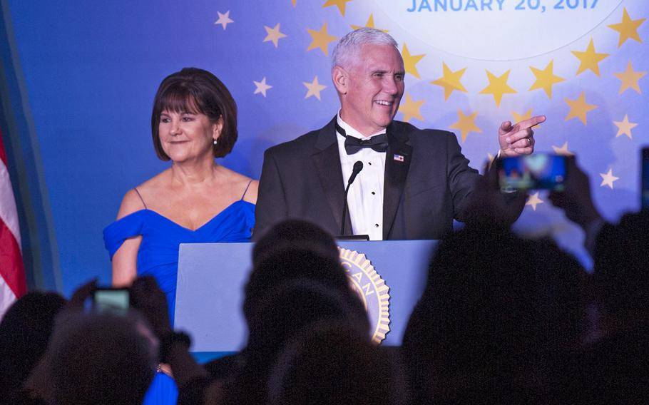 Vice President Mike Pence and his wife Karen take the stage around midnight during the Veterans Inaugural Ball: Salute to Heroes on Jan. 20, 2017.