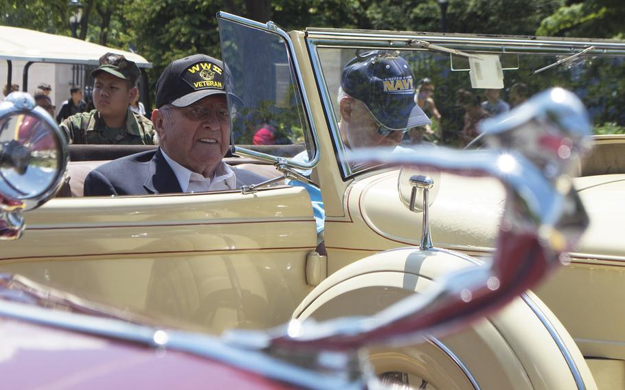 Rex Maddox, a WWII veteran, waits for the start of the Memorial Day Parade in Washington, D.C., May 29, 2017. He was in one of several cars that carried WWII veterans through the parade.