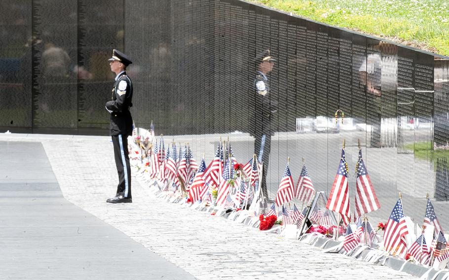 A lone servicemember stands near the Vietnam Wall at the start of the Memorial Day ceremony on May 29, 2017.