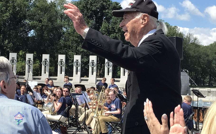 Herman Zeitchik waves to the crowd gathered for the 73rd D-Day commemoration at the World War II Memorial on June 6, 2017. Zeitchik served with the 4th Infantry Division Field Artillery and took part in the Nromandy Invasion on June 6, 1944. He was part of the first wave, landing on Utah Beach at H-Hour. He also took part inthe Liberation of Paris and the liberation of Dachau Concentration Camp.