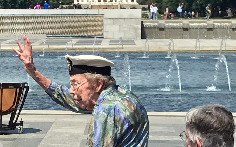 Geraldine Lohman Corn waves to the crowd at the commemoration of the 73rd anniversary of D-Day. Corn was a Navy nurse on the home front, caring for wounded back from duty in the Pacific.