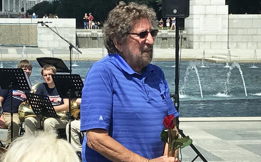 Harry Miller stands for the crowd during the 73rd commemoration of D-Day at the World War II Memorial in Washington, D.C., on June 6, 2017.  Miller served the 740th Tank Battalion, taking part in the Battle of the Bulge. He also served in the Korean War and the Vietnam War.