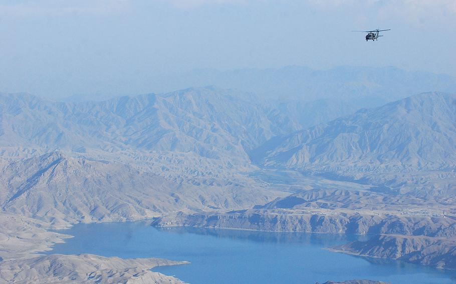 UH-60L Black Hawk helicopter crewed by members of the Massachusetts National Guard flies over eastern Afghanistan on Oct. 11, 2013.